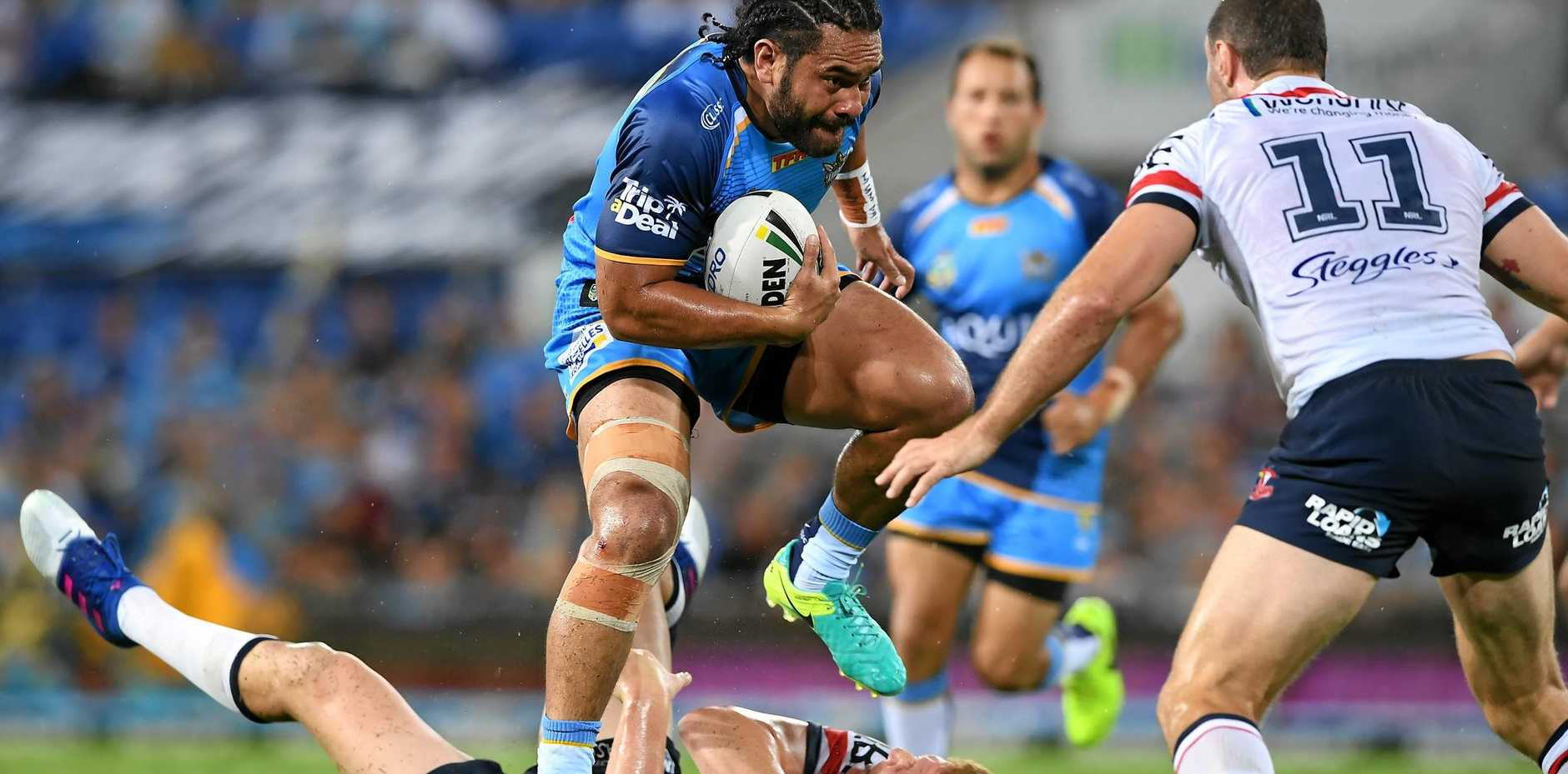 Titans player Konrad Hurrell takes the ball forward against the Sydney Roosters in round one.