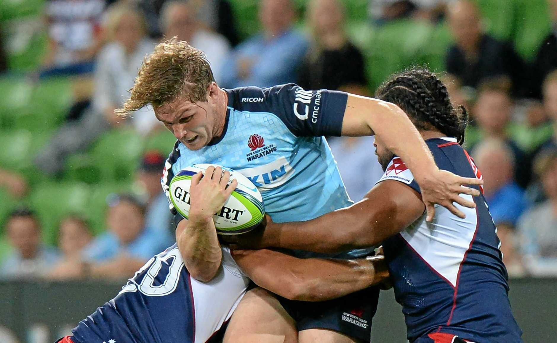 Michael Hooper makes a charge against the Melbourne Rebels.