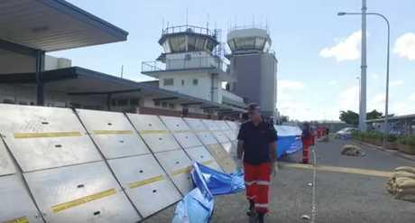 FLOOD BARRICADE: Flood barricades are being set up at Rockhampton's airport.