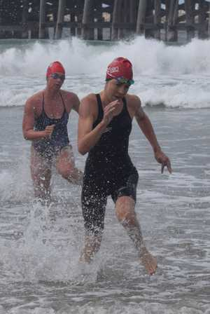 CLOSE FINISH: Meegan Hoare is closely followed by Mette Klinkers for the honour of being the first female to win the 2000 metre event at the 2017 Beachside Radiology Coffs Ocean Swims. 2 April 2017 Jetty Beach Coffs Harbour Photo: Brad Greenshields/Coffs Coast Advocate