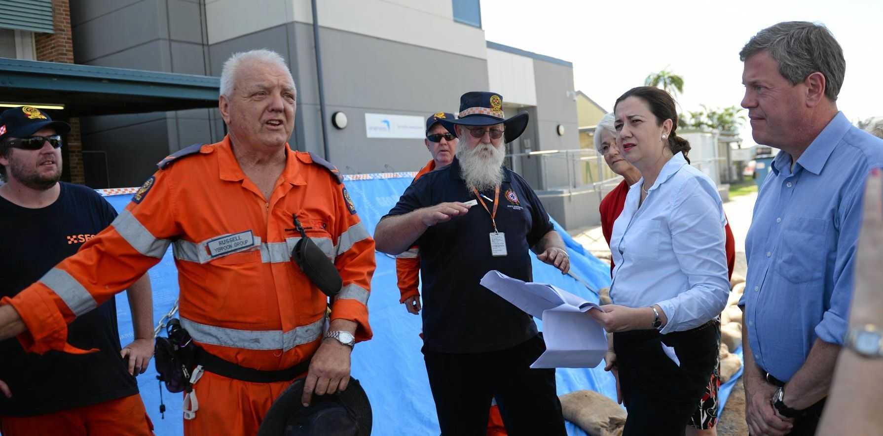 Qld Premier Annastacia Palaszczuk speak a SES volunteer at Rockhampton Airport.