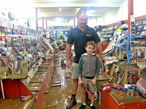 Keiran Scott and his son Sebastian have a long road ahead to clean up their newsagency in Molesworth St, Lismore.