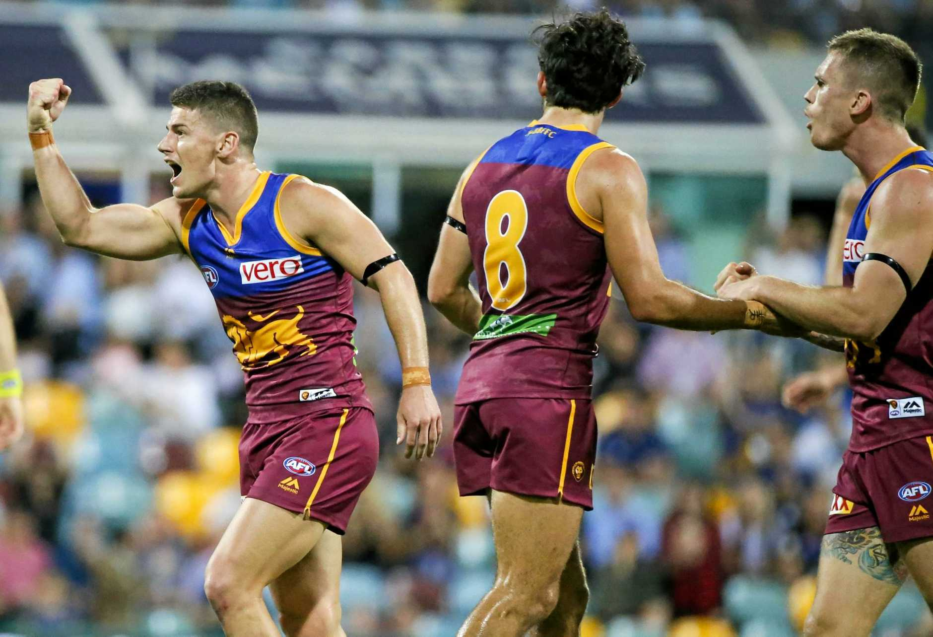 Dayne Zorko of the Lions celebrates after scoring a goal during the Round 2 AFL match between the Brisbane Lions and the Essendon Bombers at the Gabba in Brisbane, Saturday, April 1, 2017. (AAP Image/Glenn Hunt) NO ARCHIVING, EDITORIAL USE ONLY