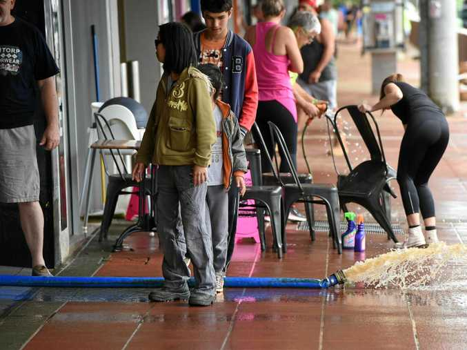 Stores in Lismore cleanup after the flood waters reced along Woodlark Street.