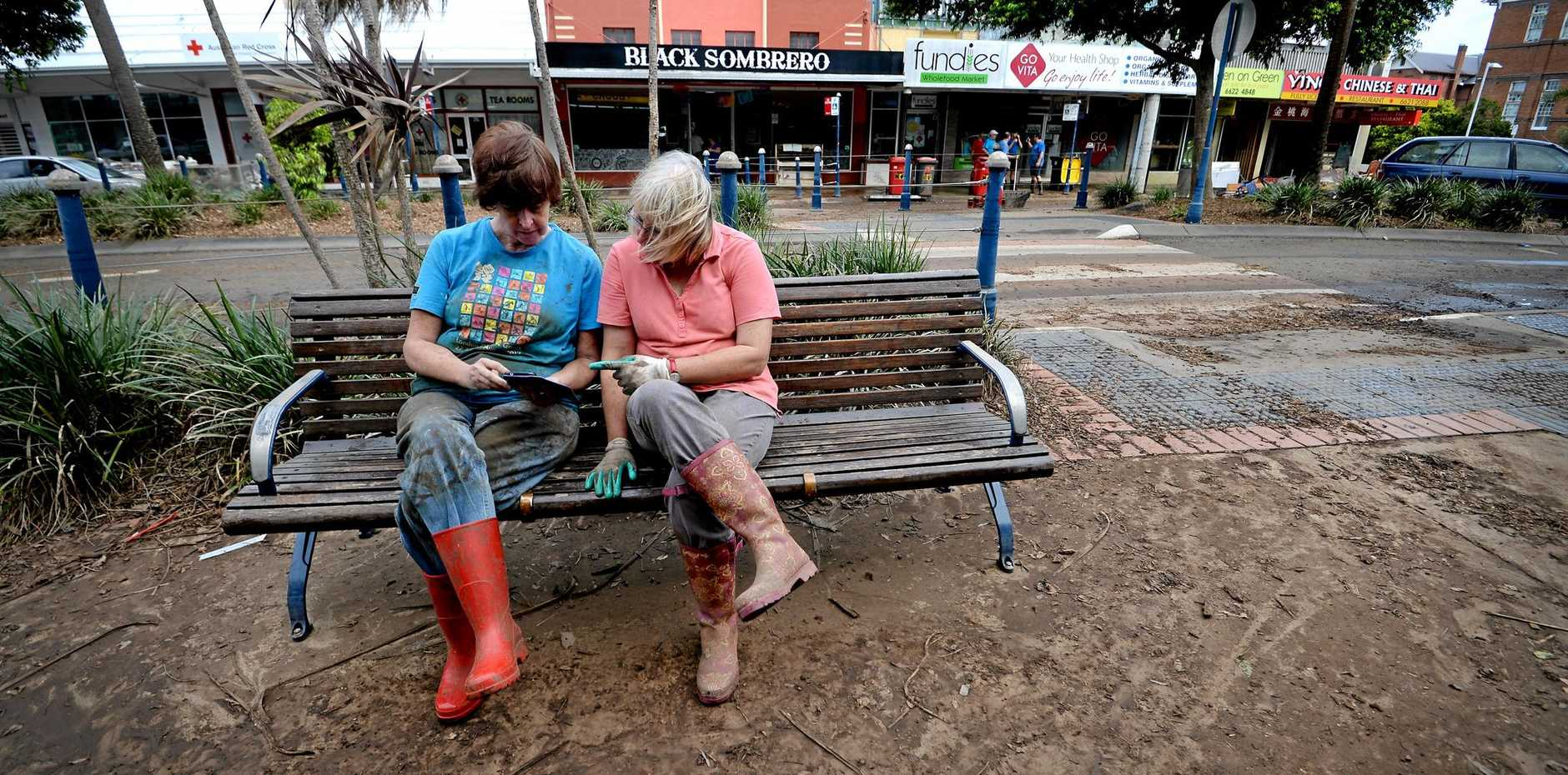 Wendy Wilson and Leanne Beattistuzzi, of Lismore, take a break from cleaning up.