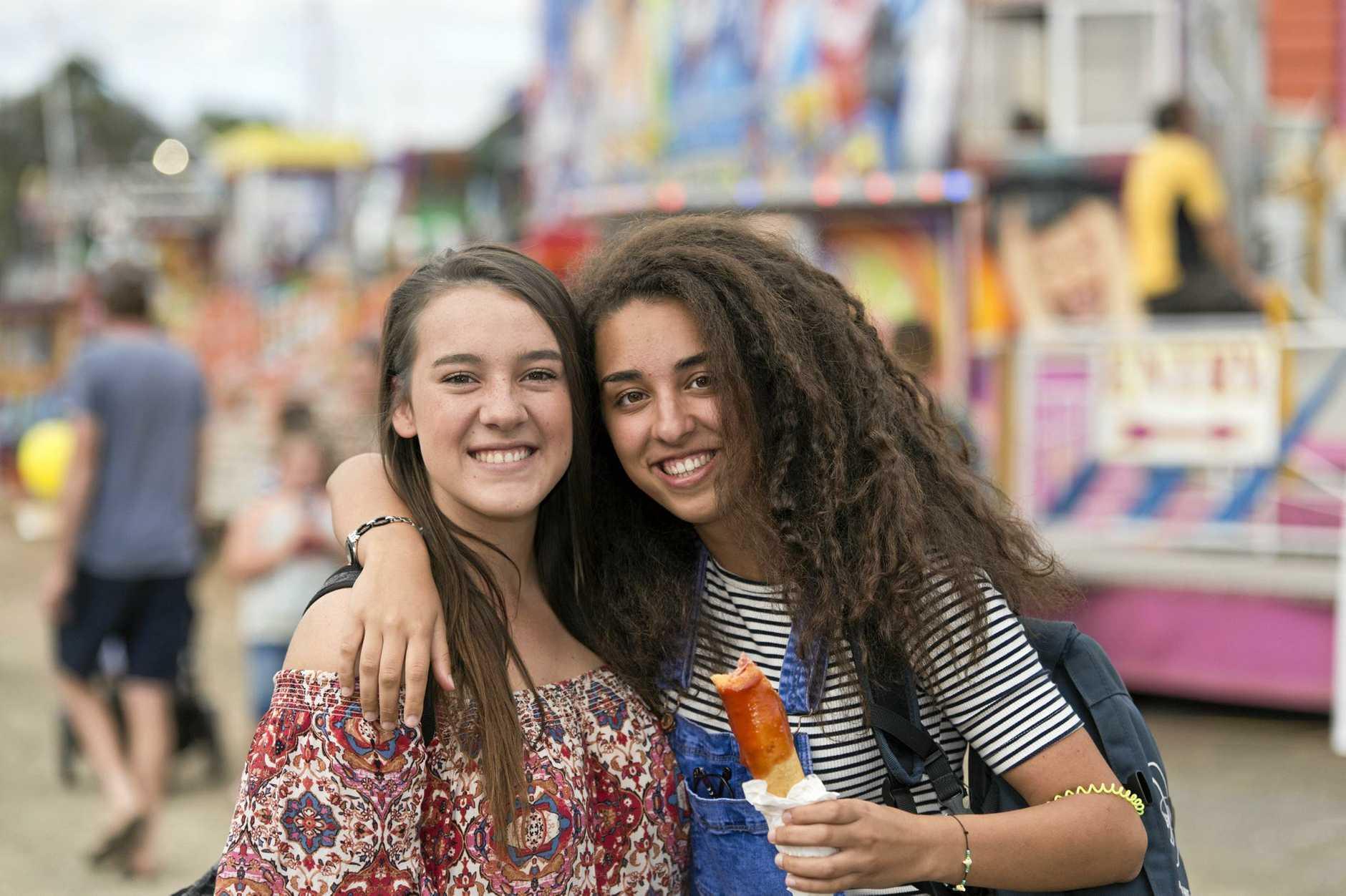 Renske Van Derwalt (left) and Anna Condotta in sideshow alley at Heritage Bank Toowoomba Royal Show, Saturday, April 1, 2017.