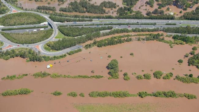 Floodwaters creeping up to the M1 in Logan.