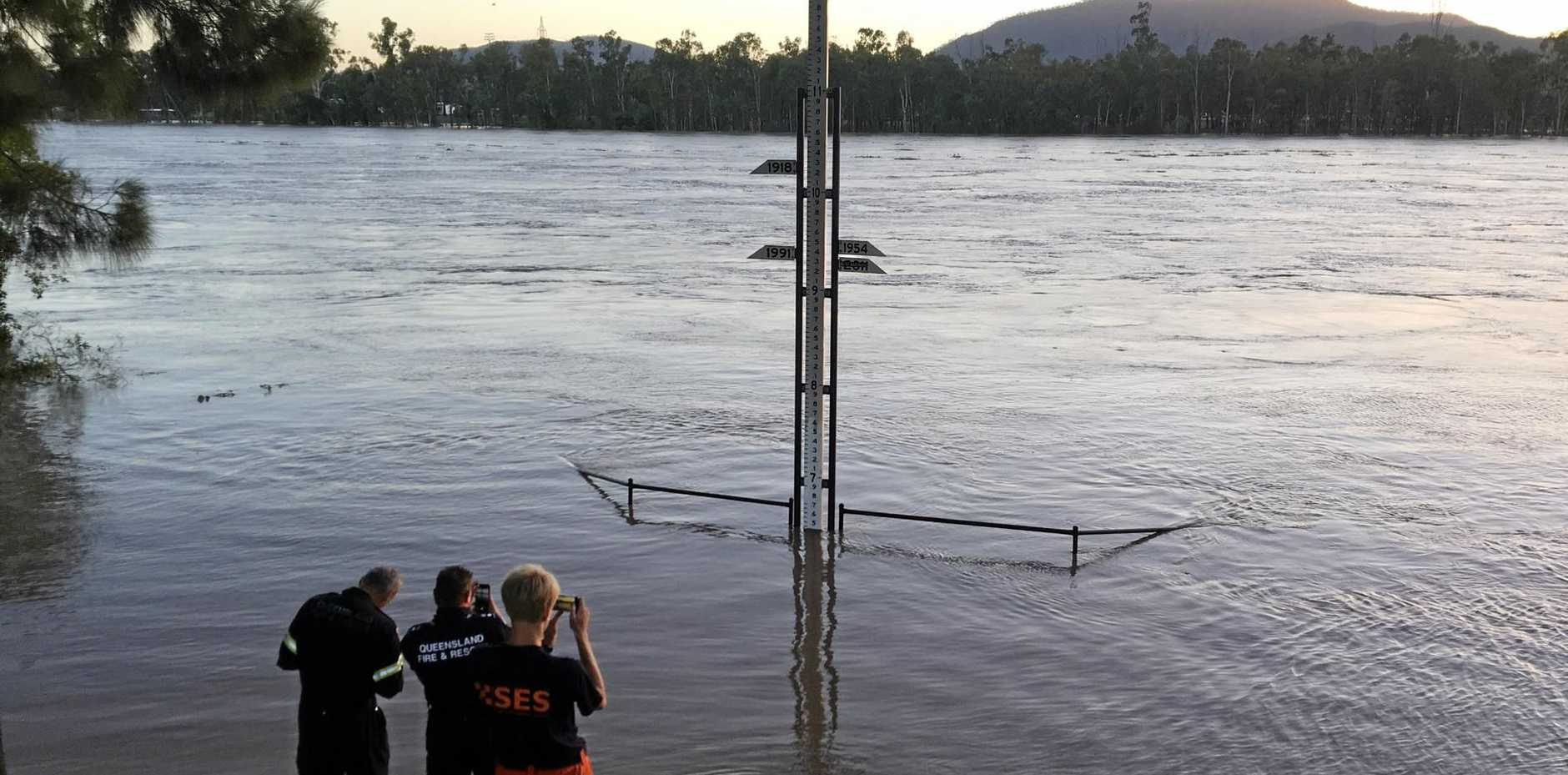 SES and QFES staff check the latest flood height as the Fitzroy River continues to rise.