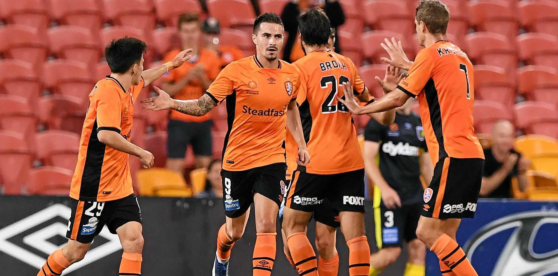 Jamie Maclaren (centre) celebrates after scoring one of his three goals against Central Coast.