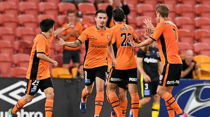Jamie Maclaren (centre) celebrates after scoring one of his three goals against Central Coast.