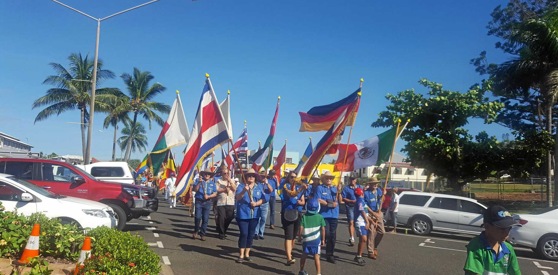 UNITED: Yeppoon Lions, lionesses and visiting lions, led a 200-strong, colourful parade in James Street, featuring 93 international flags and many banners  voluntary and essential service organisations.