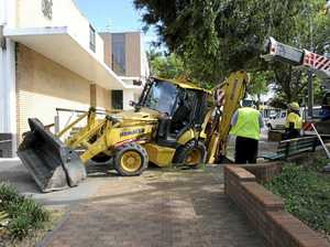 Backhoe stuck in pavement