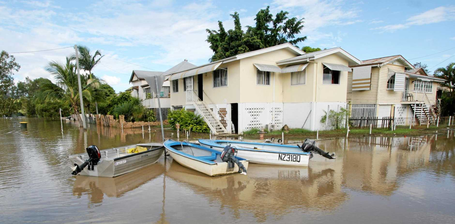 2011 PHOTO: Tinies are tied to a street sign in Depot Hill as residents continue to use small boats to get to their homes still cut off from the rest of Rockhampton by flood waters.