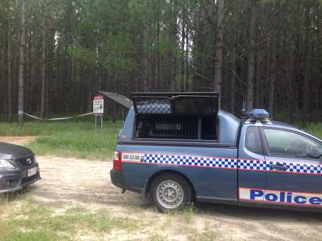 Police on the scene where a body was found north of Caboolture