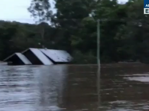 WATCH: House disappears in floods after family rescued