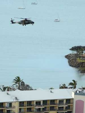 A military helicopter arrives at Airlie Beach after Cyclone Debbie. Picture: Liam Kidston