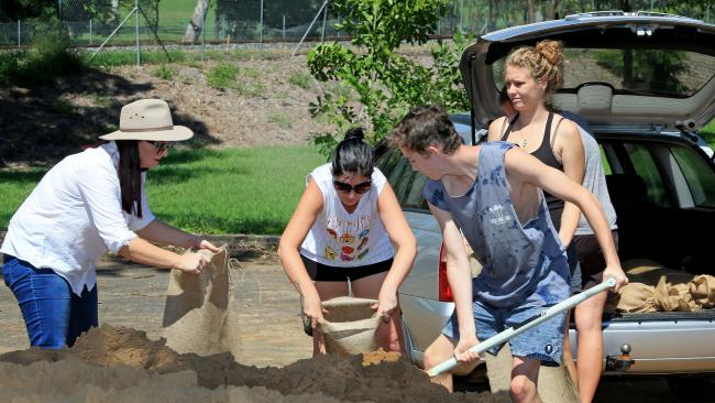 Member for Keppel Brittany Lauga ith Emma Carter, Isaac Mobbs and Raelene Lappin, preparing sandbags.