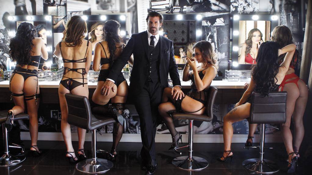 Travers Beynon, 'The Candyman' with his bevy of beautiful women (he has his hand on his wife's bottom)
