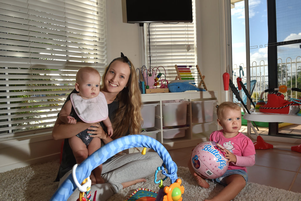 BABY LOVE: Tess Murray, pictured here with Ava and Piper Smith, is offering free nannying for twins and newborns.