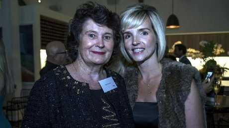 Billionaire heiress Angela Bennett, left, poses for a rare photograph, with Terri Ann McLarty.