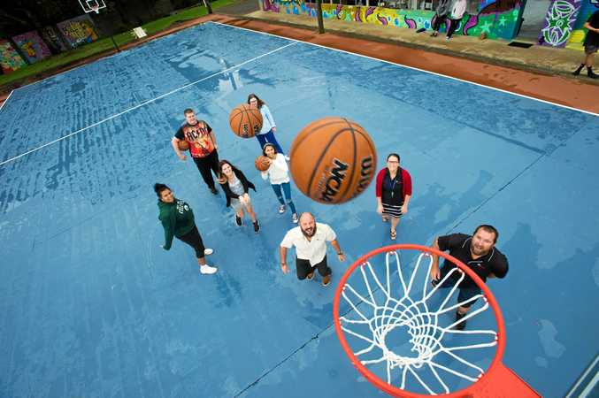 Key Employment staff Nathan Hansford, Hannah Fenner and Allan McKibbin with KAPOW students on the newly painted basketball courts at West Coffs.