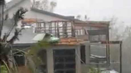 A house in Hamilton Island lost its entire roof while the owner was notified from afar while on an overseas trip.