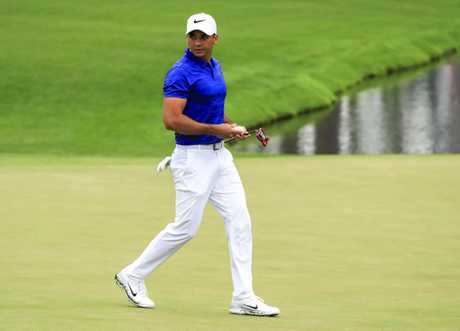 Jason Day of Australia walks across the 16th green during a practice round at Augusta.