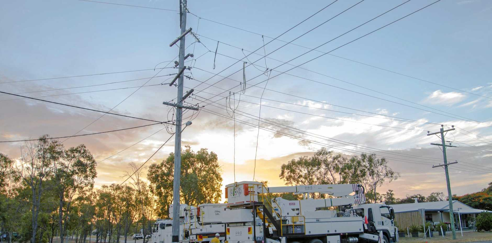 Ergon Energy workers repair damaged power lines in the Lakes Creek area.