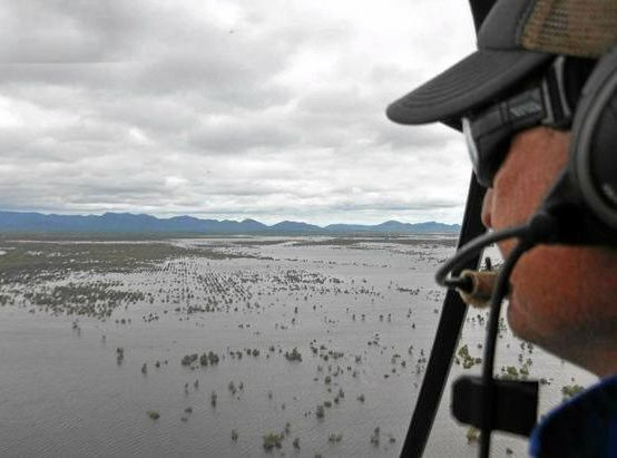 Cameron Parker looks out over flooded paddocks at Yaamba in an image posted to his Facebook page.
