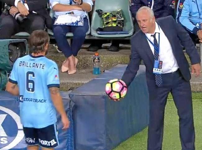 Graham Arnold tells Josh Brillante to get a yellow card.