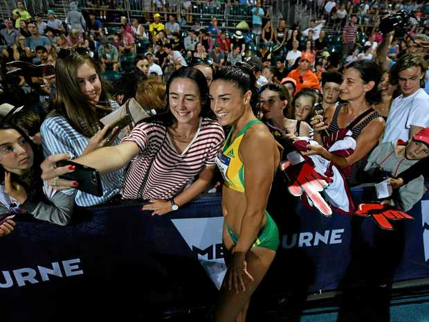 Michelle Jenneke of Australia with fans after winning the women's 100m hurdles during the Nitro Athletics Series in February.