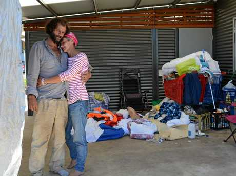 FORGOTTEN: Aaron Burke, 34, and partner Michelle Sharpe, 43, sit amidst everything they own in a makeshift shelter at Clewley Park off Water St. It has been the couple's home for two months.