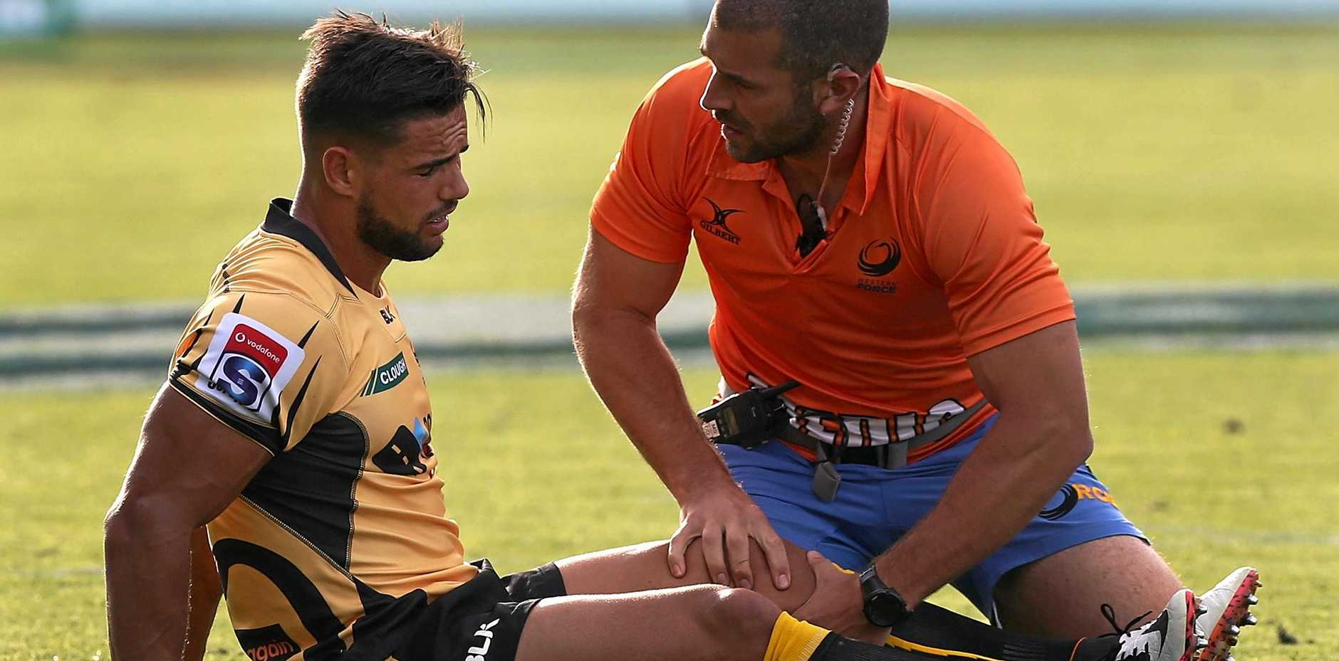 Ryan Louwrens of the Force is checked by a team doctor during the round six Super Rugby match against the Blues.