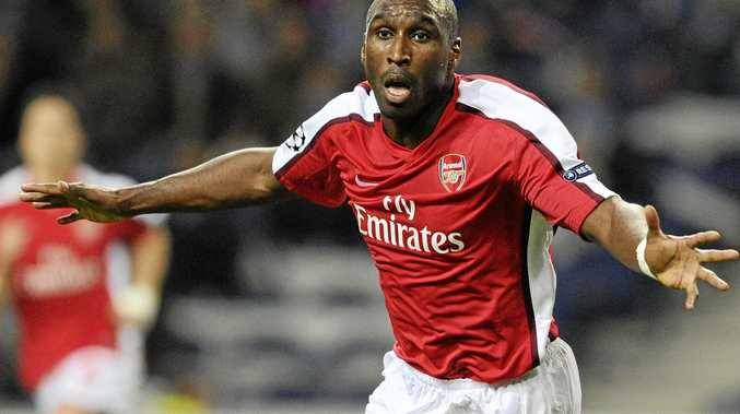 FILE - This is a Wednesday, Feb. 17, 2010 file photo of Arsenal's Sol Campbell  as he celebrates after scoring against FC Porto in a Champions League round of 16 first leg soccer match at Porto's Dragon Stadium in Porto, Portugal. Campbell announced his retirement from soccer Wednesday May 2, 2012.  (AP Photo/Paulo Duarte, File)