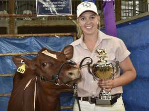 Nicole Priebbenow celebrates winning Juvenile Dairy Champion with Silverleigh Gina 40 at the 2017 Heritage Bank Toowoomba Royal Show. Heritage Bank Toowoomba Royal Show, day 2. March 2017