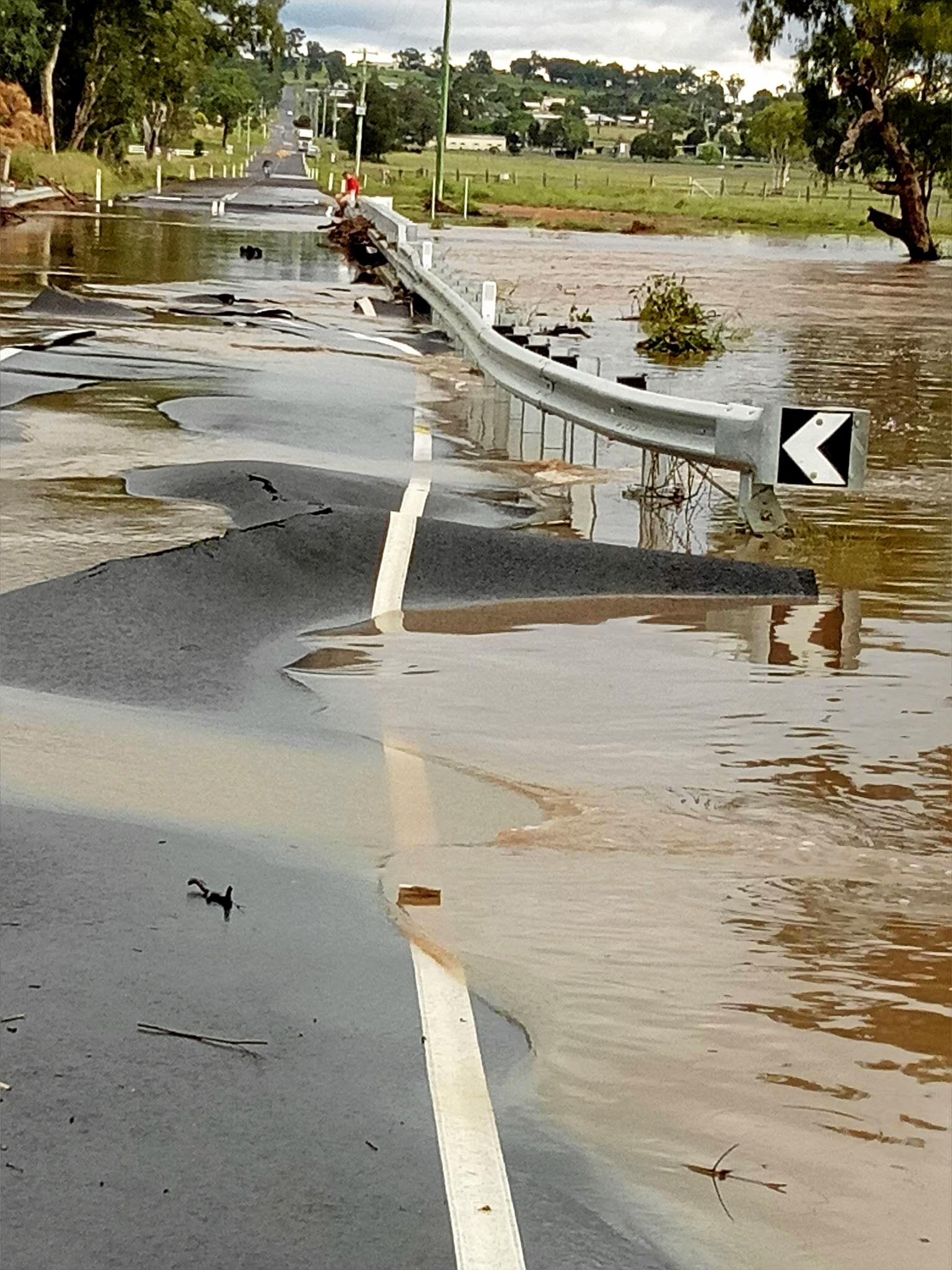 CRACKED UP: Kerri Stone Burmester shared this photo of Lyndhurst Lane Bridge damaged by floodwaters on Warwick Community Noticeboard this morning.