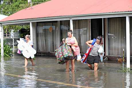 Cyclone coverage Felicity Allen , Ashley and Kristy Bourke evacuating their home , Flooding in North Eton near Mackay. Pic Annette Dew
