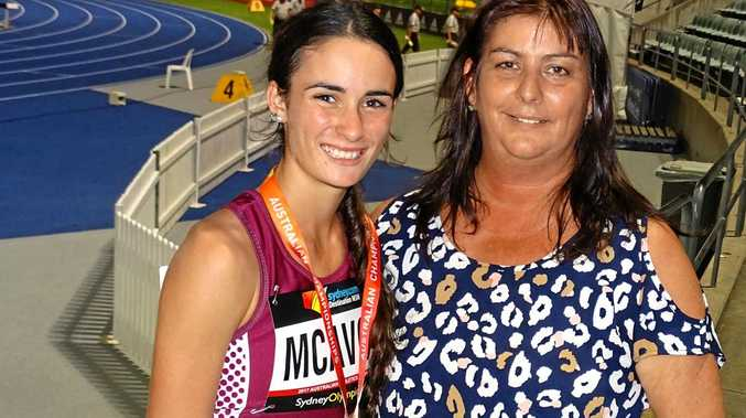 Ipswich and District Athletic Club gold medal winner Montanna McAvoy with supportive mum Alicia at the national titles in Sydney.
