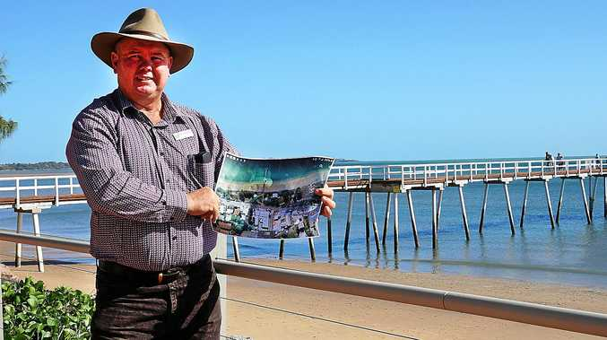LIGHT IT UP: Cr Denis Chapman displays the proposed area for the Scarness beach lights, which would cover an area of 300m of the foreshore