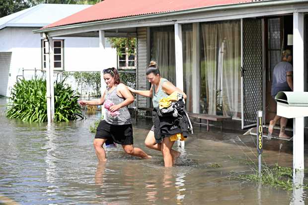 Ashley and Kristy Bourke evacuating their home as flooding hits North Eton.