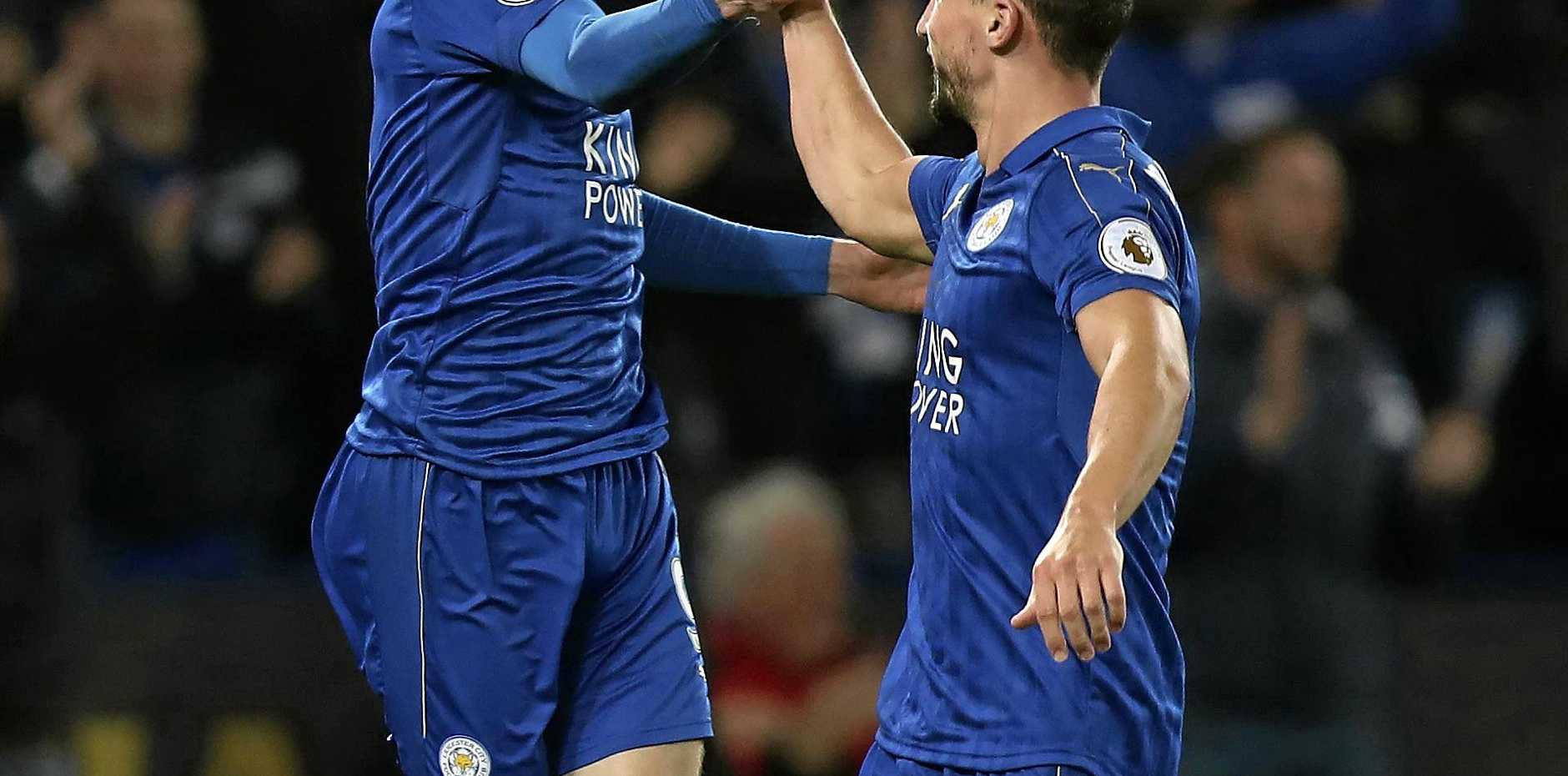 Leicester City's Jamie Vardy celebrates scoring his sides second goal with Daniel Drinkwater, right, during the English Premier League match, Leicester against Sunderland at the King Power Stadium, Leicester, England, Tuesday April 4, 2017. (Mike Egerton/PA via AP)
