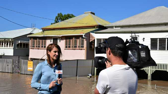 FRONT LINE: Channel 7 Sunrise's newsreader Natalie Barr reporting on the Rockhampton floods from Quay St, Depot Hill.