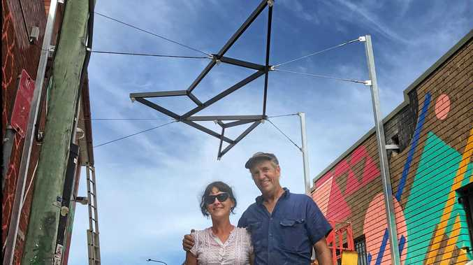 THROWING SHAPES: Installation of Harley Graham and Max Beaur's sky sculpture at Elysium Creative Road project in Lateen Road Byron Bay. The installation was done Andrew Swain seen here with curator Rebecca Townsend.