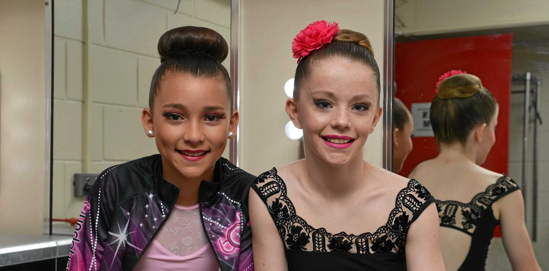 LOCAL GIRLS: Chloe ONeill and Paige ODea waiting for their performance at the Bundaberg festival of Dance at the Moncrief Theatre.