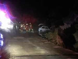 WATCH: Car crashes into creek; swiftwater rescuers respond