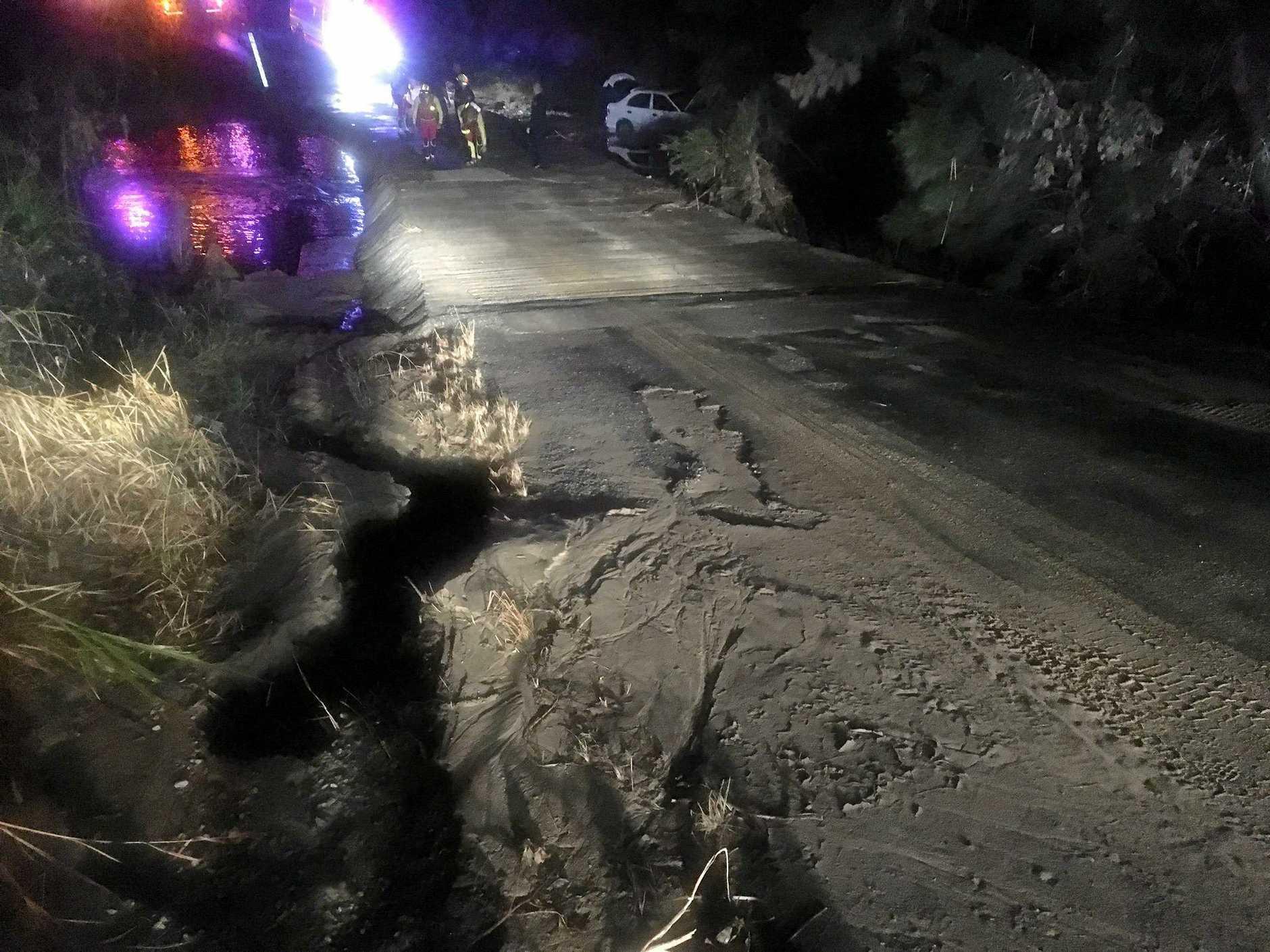 Road damage from floodwaters last week near bridge