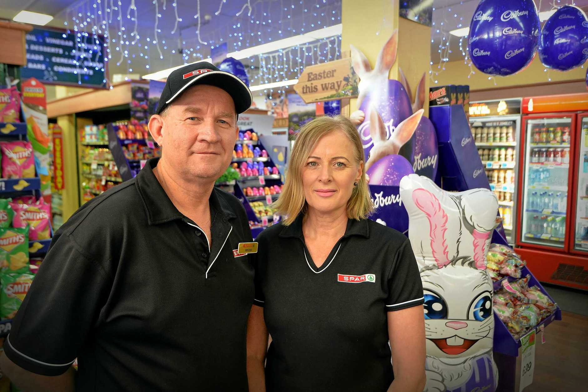Bruce and Sue Luchterhand of SPAR supermarket, Alexandra Headland, are losing out because of trading hours changes that allow Coles, Woolworths and ALDI to open early and close late.
