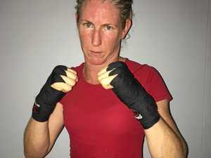 Teacher ready to deliver MMA lesson in Brisbane