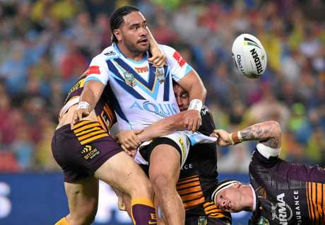 Titans player Konrad Hurrell offloads the ball.