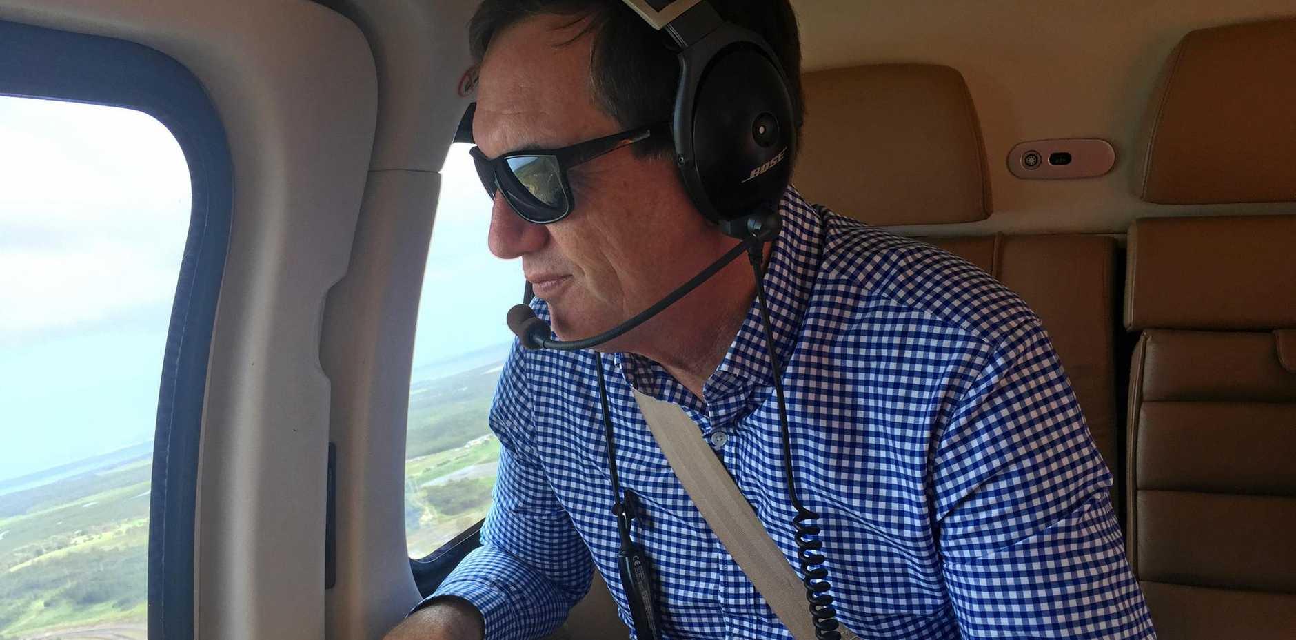 Minister Anthony Lynham flies over the region, inspecting rail damage
